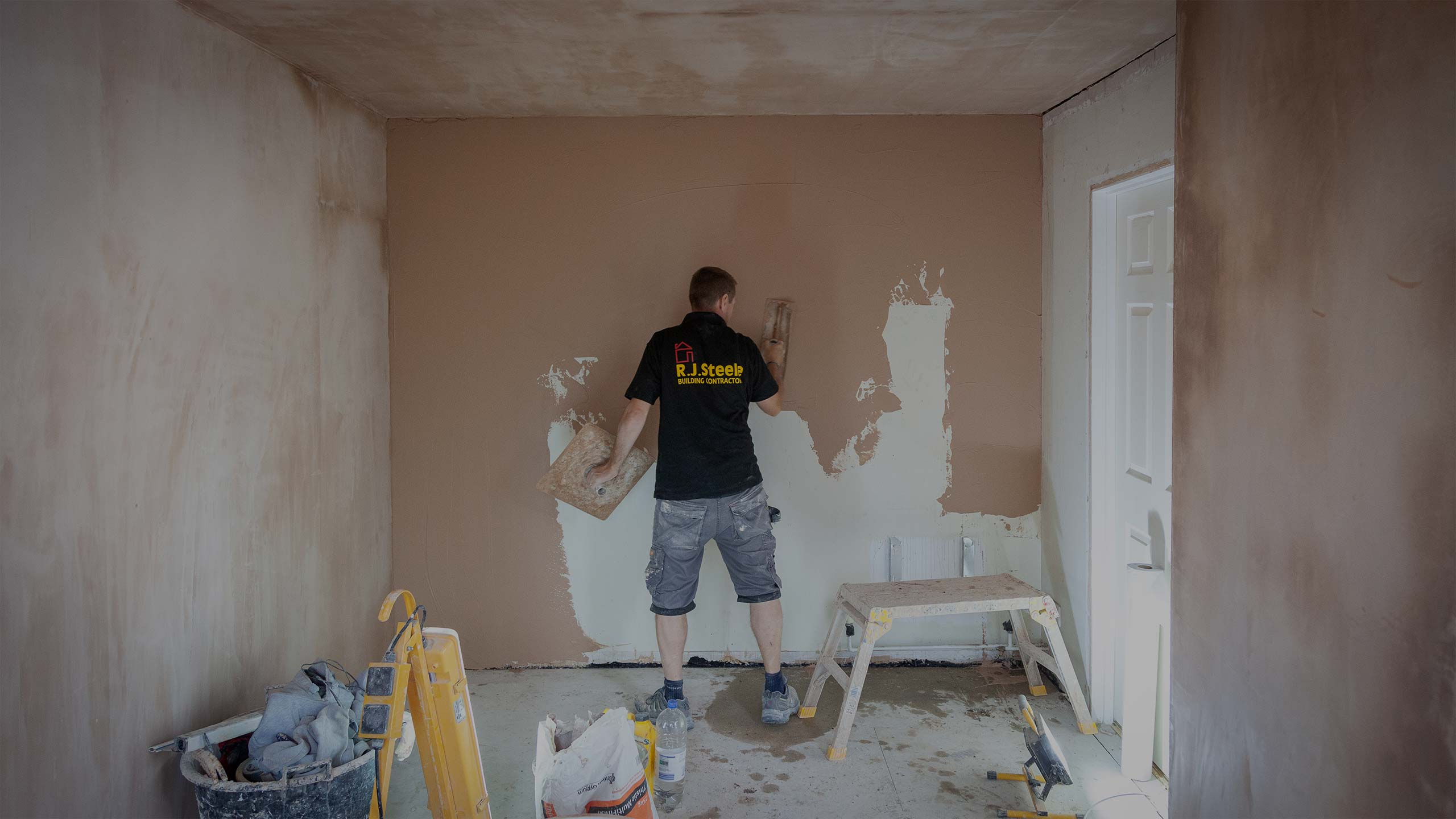 Plasterer at work - decorating and building work by RJ Steeles builders