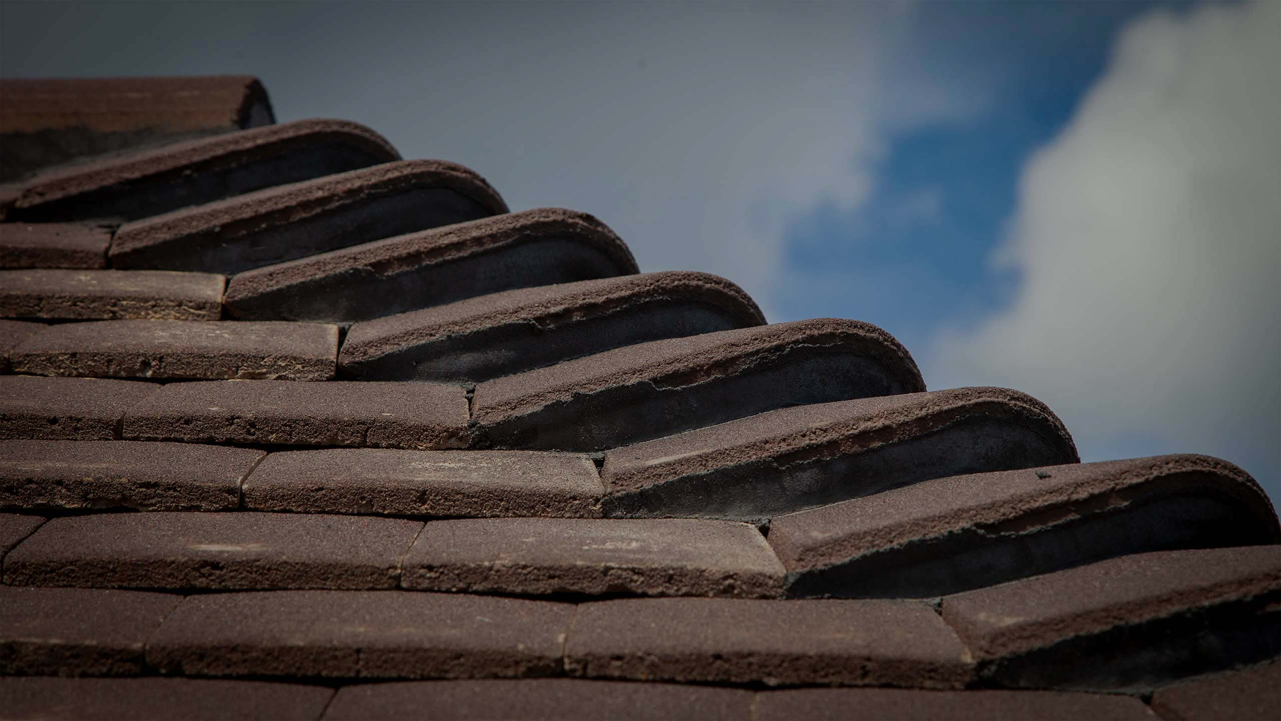 Ridge of a tiled roof by roofing specialists RJ Steeles builders in Sussex
