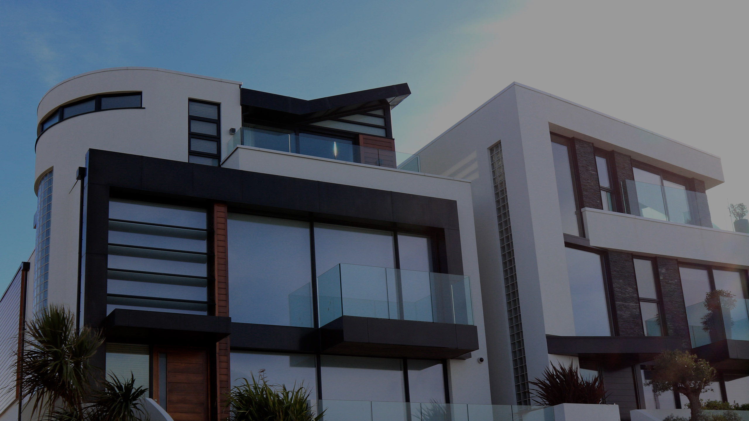 Modern house exteriors - illustrating building work by RJ Steeles new house builders