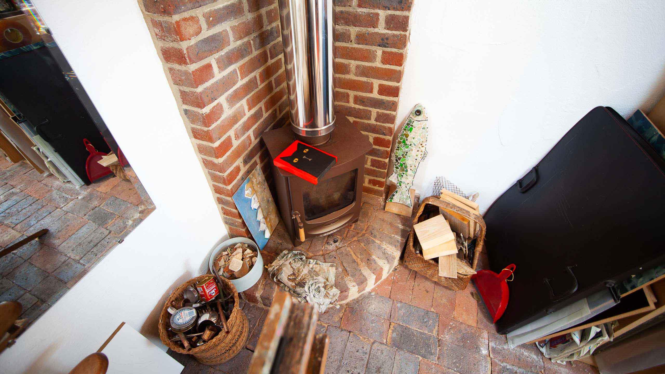 wood burning stove in garage conversion studio - building work by RJ Steele builders in Sussex