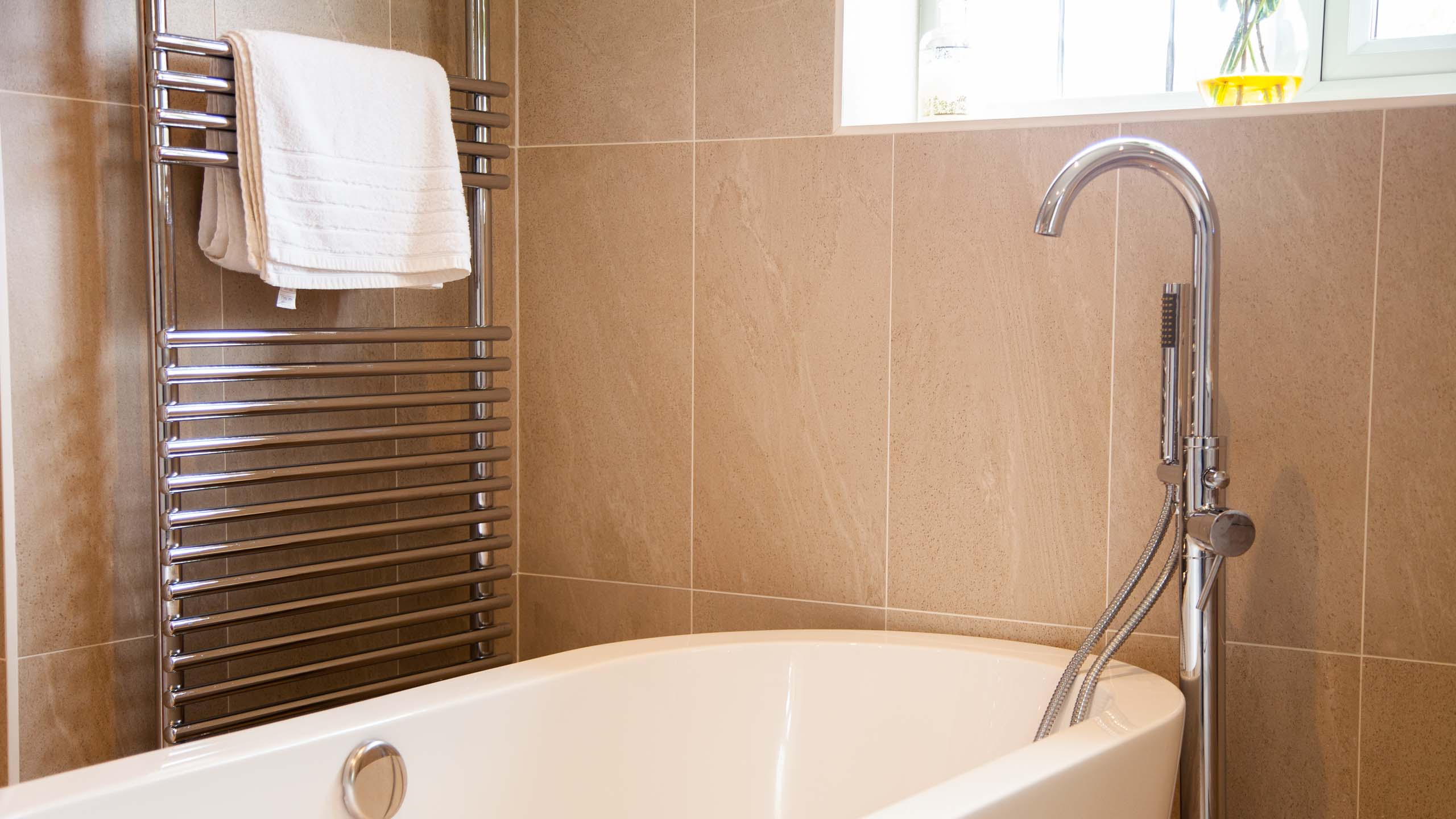 modern bath and radiator - bathroom installation by RJ Steele builders in Sussex