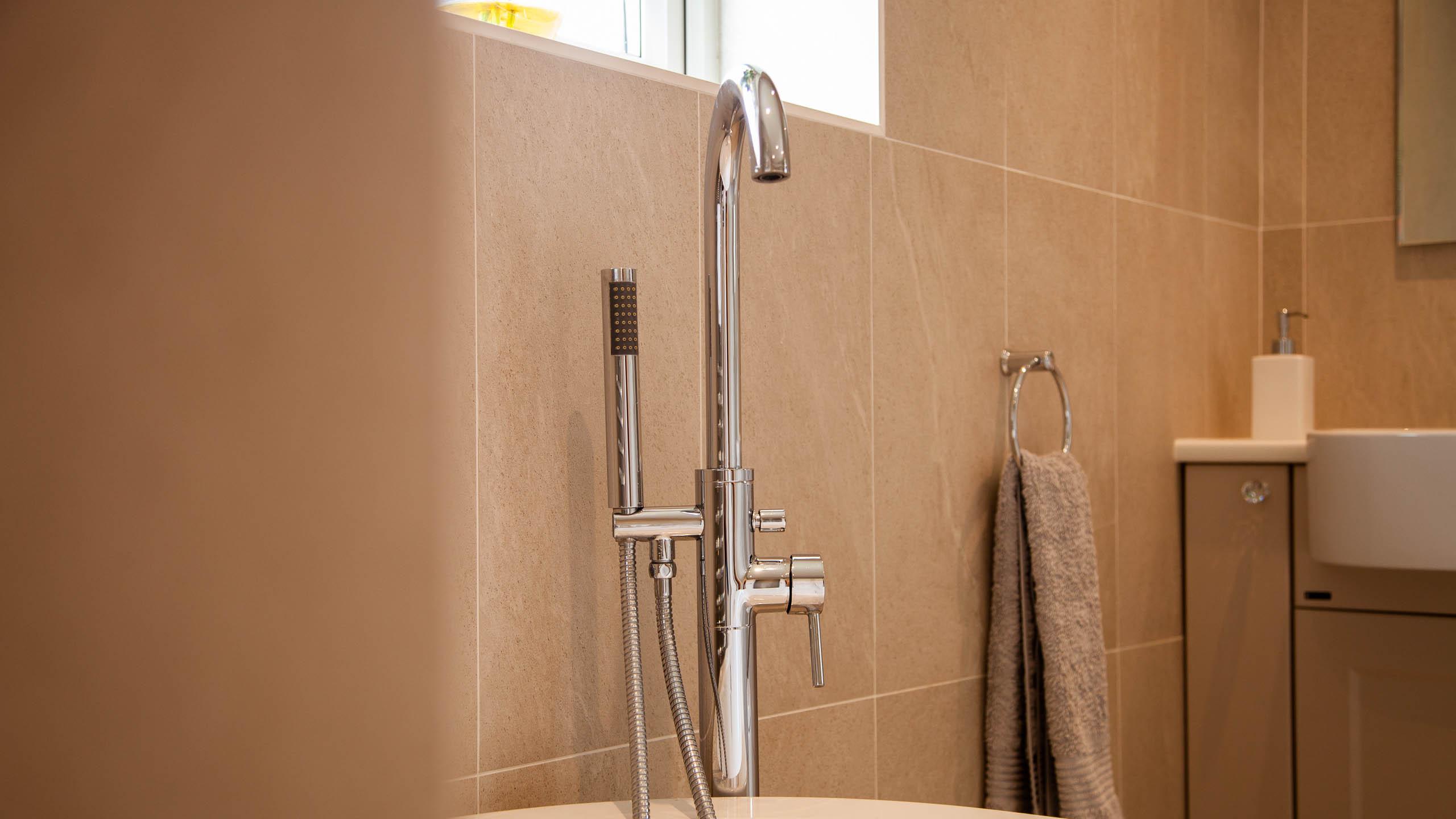 modern bathroom bath tap - bathroom installation by RJ Steele builders in Sussex
